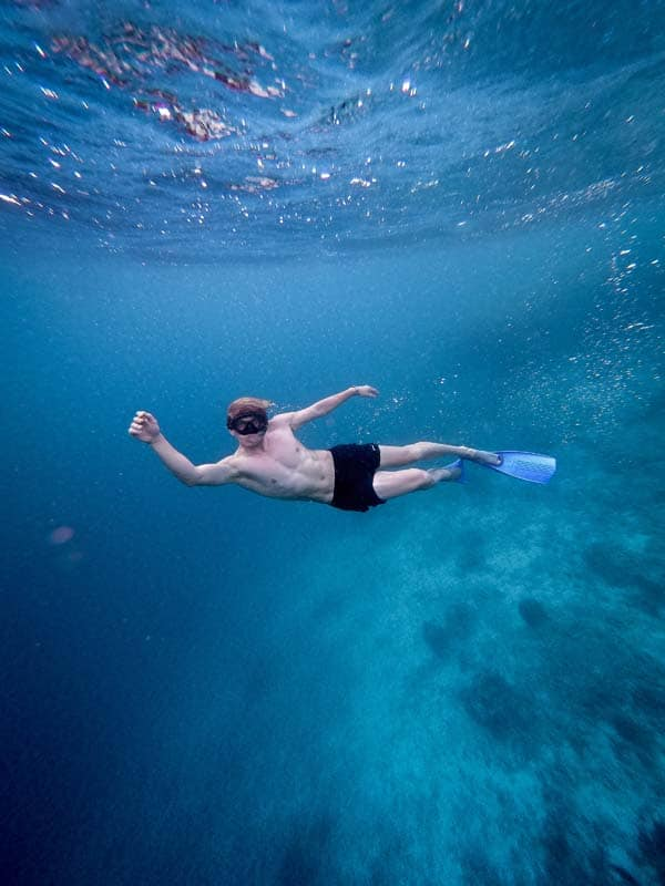 Diver in a water with flippers & a mask